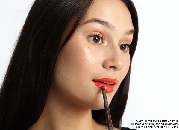 MAKE UP FOR EVER Artist Acrylip 200 Candy Prink and MAKE UP FOR EVER Artist Acrylip 300 Orange applied to lips