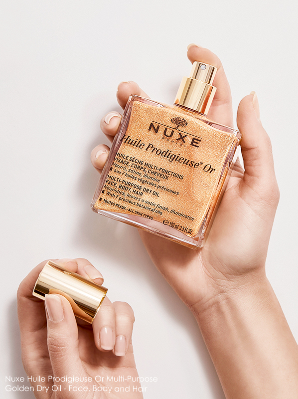 Image of Nuxe Huile Prodigieuse Or Multi-Purpose Golden Dry Oil Face, Body and Hair Spray held in hand