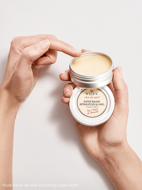 Image of Nuxe Reve de Miel Repairing Super Balm held in hand