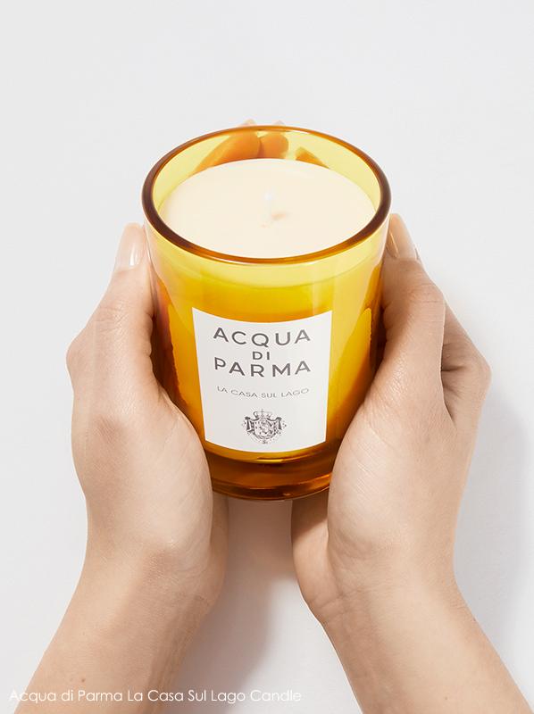 Image of Acqua di Parma La Casa Sul Lago Candle being held in hands
