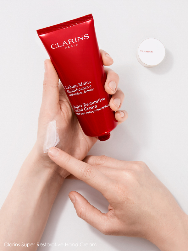 Image of Clarins Super Restorative Hand Cream being applied to hands