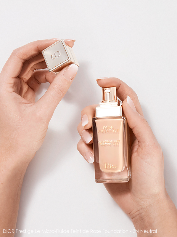 Image of DIOR Prestige Le Micro-Fluide Teint de Rose Foundation in 3N Neutral being held in hands