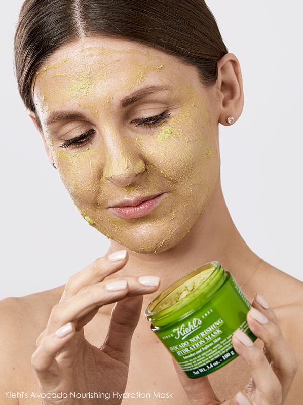 Image of model wearing and applying Kiehl's Avocado Nourishing Hydration Mask