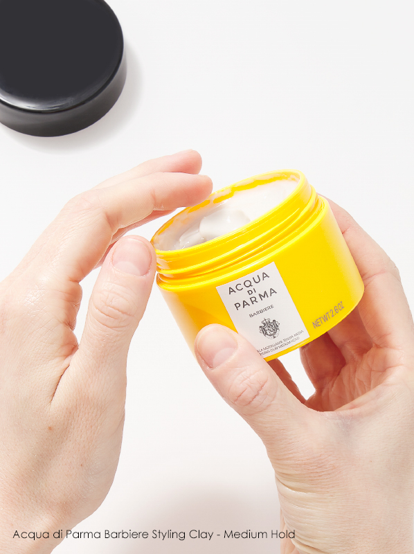 Image of Acqua di Parma Barbiere Styling Clay - Medium Hold held in hands