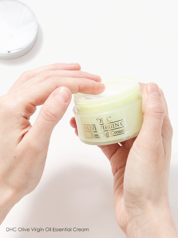 Image of DHC Olive Virgin Oil Essential Cream held in hands