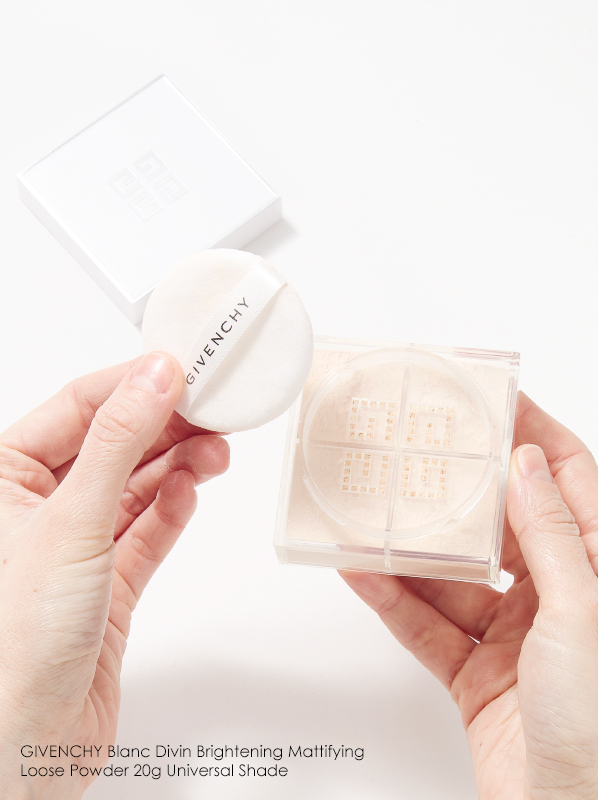 Image of GIVENCHY Blanc Divin Brightening Mattifying Loose Powder held in hands
