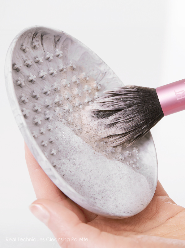 Hand Holding Real Techniques Brush Cleansing Palette