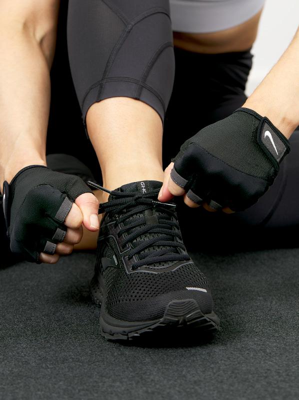 Image of running shoe being tied