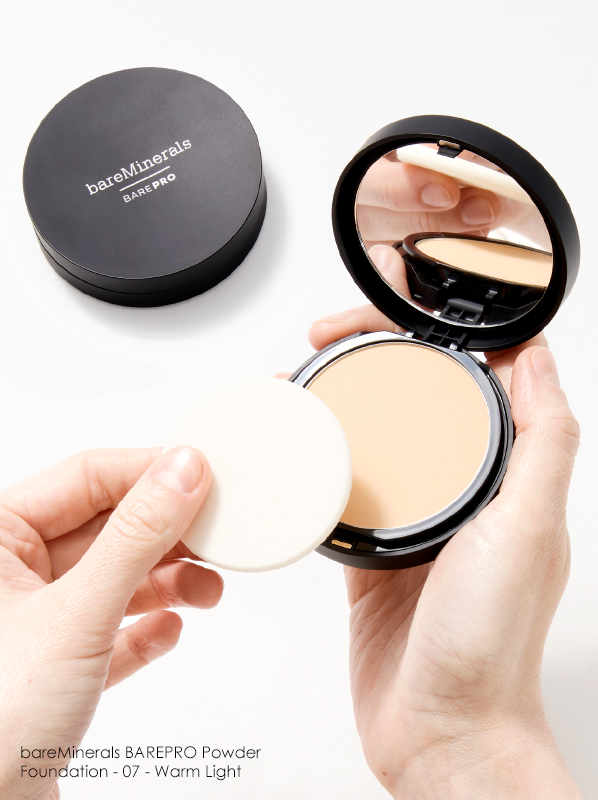 Hand image of bareMinerals BAREPRO Powder Foundation in shade 07 Warm light
