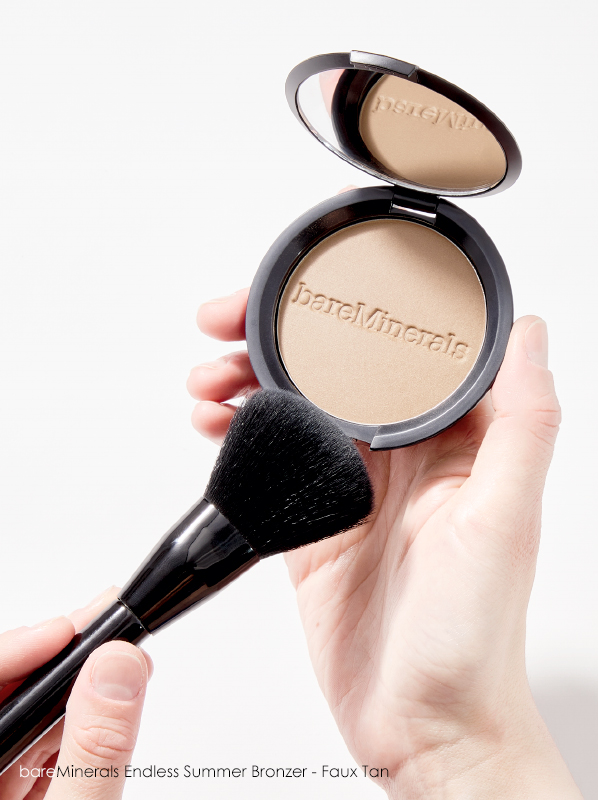 Hand image of bareMinerals Endless Summer Bronzer - Faux Tan