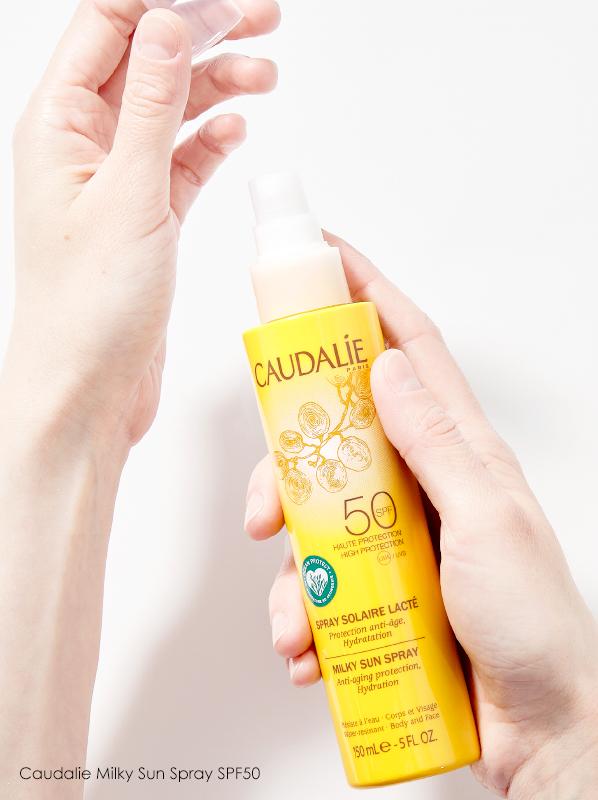 clean spf: Hand image of Caudalie Milky Sun Spray SPF50