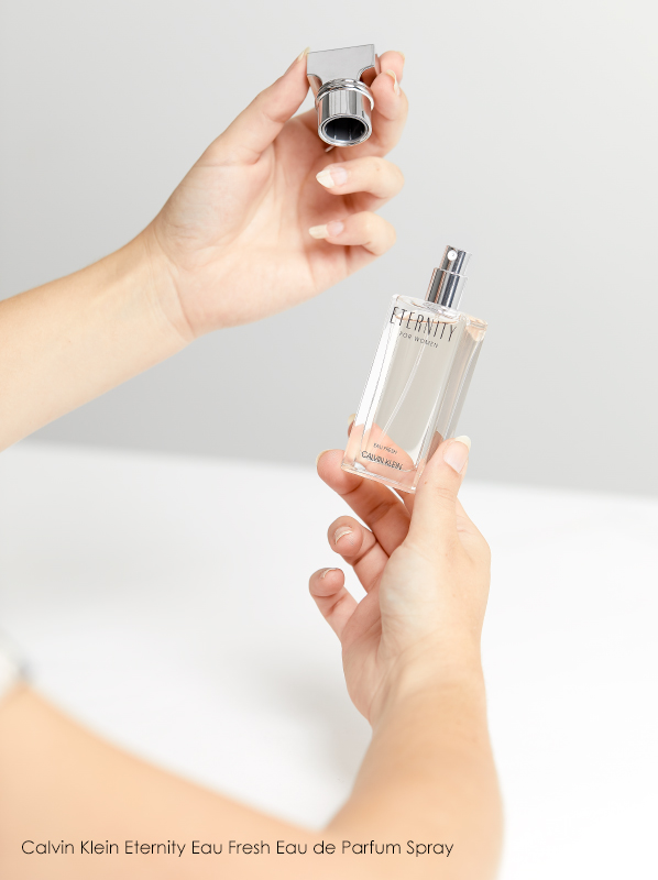 Hand image holding Calvin Klein Eternity Eau Fresh Eau de Parfum bottle