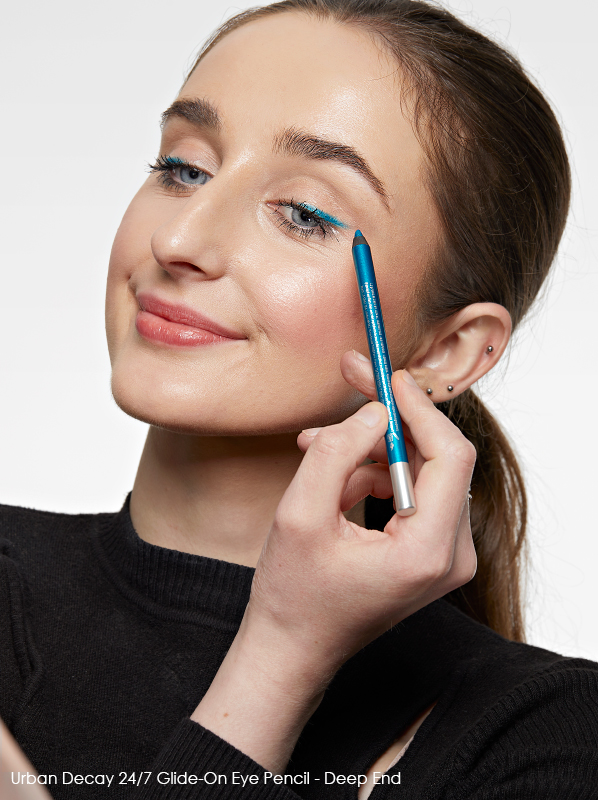 Image of model applying Urban Decay 24/7 Glide-On Eye Pencil in shade deep end over the eye lids to boost her mood