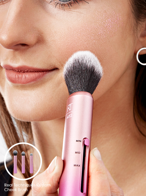 Model using Real Techniques Custom Cheek Brush in a edit of the best travel makeup brushes