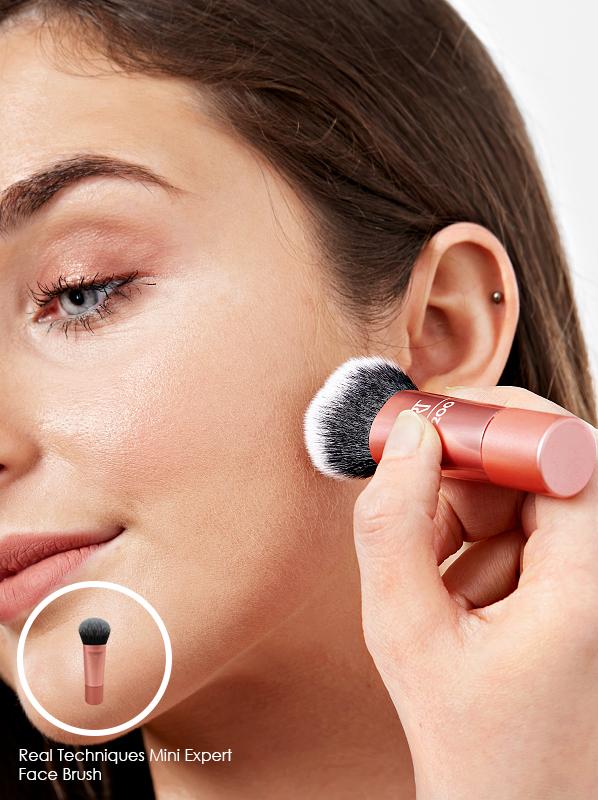 Model using Real Techniques Mini Expert Face Brush