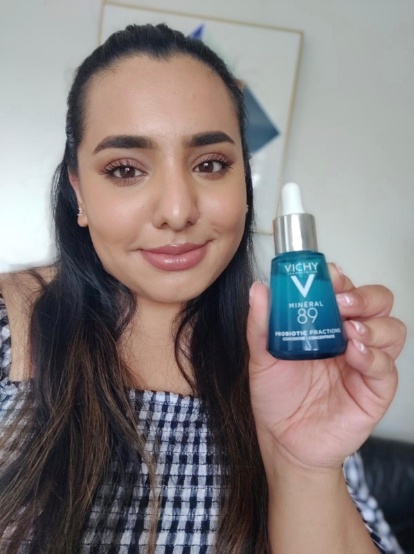 Model holding the new beauty July 2021 release Mineral 89 Probiotic Fractions