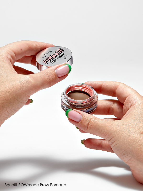 Hand opening Powmade Eyebrow Pomade for a review